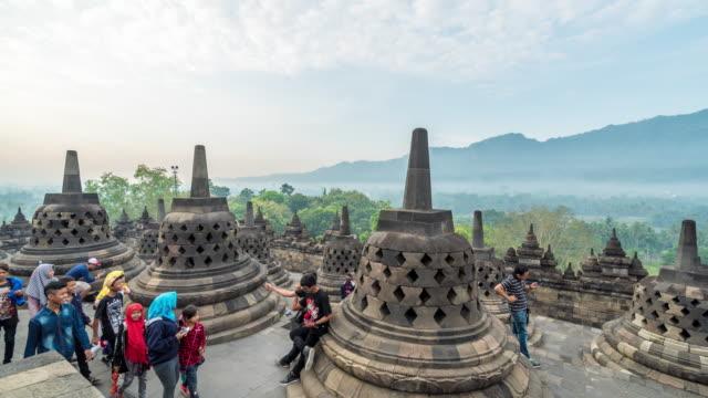 vídeos y material grabado en eventos de stock de lapso de tiempo en 4k : estatua de buda en templo de borobudur, java, indonesia - java