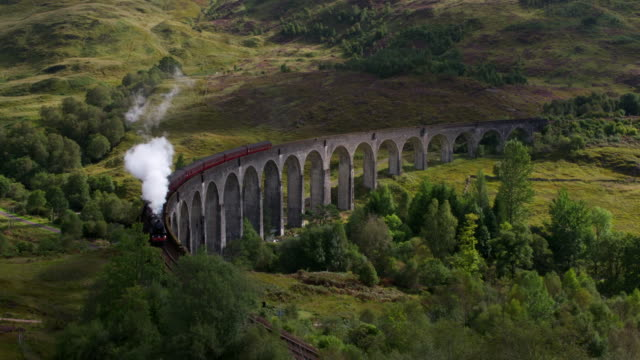 time lapse. steam train passes over curved glenfinnan viaduct. glenfinnan, scottish highlands, scotland, uk. - viaduct stock videos & royalty-free footage