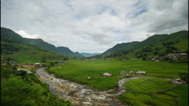time lapse step rice field and canal trough the country village sa pa lao cai, vietnam - sa pa stock videos and b-roll footage