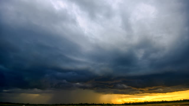 time lapse: storm cloud rain over lake episode sunset - extreme weather stock videos & royalty-free footage