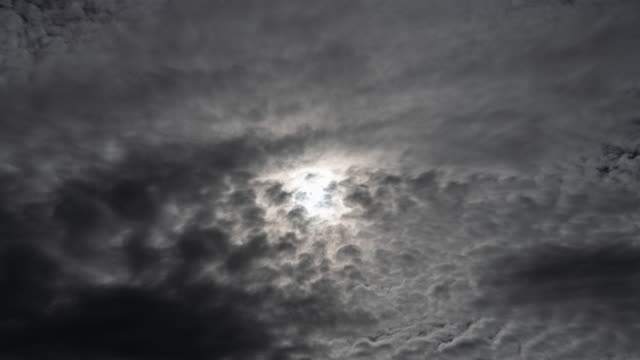 time lapse storm clouds are coming and covering the sun - surrealism stock videos & royalty-free footage