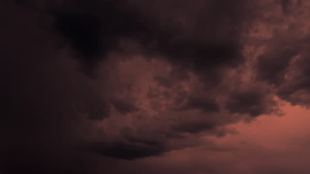 Time lapse stormclouds in a red sky