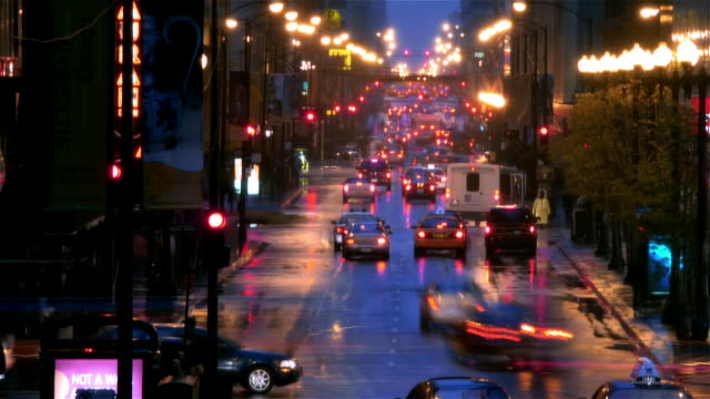 time lapse street traffic on rainy night with elevated train overhead / chicago, illinois - traffic light stock videos & royalty-free footage