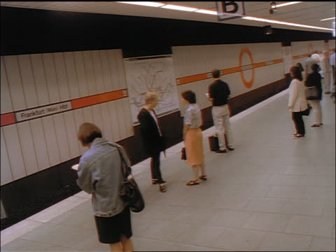 time lapse subway (s-bahn) pulling into station / passengers get on + off / train leaves / frankfurt - 1998 stock-videos und b-roll-filmmaterial