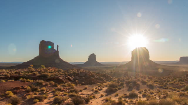 ws time lapse sun shining over monument national park buttes,utah,united states - monument valley stock videos & royalty-free footage