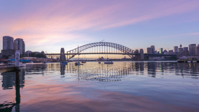 time lapse. sunrise at sydney harbour bridge - international landmark stock videos & royalty-free footage
