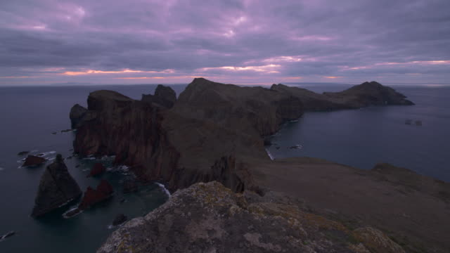 Time Lapse. Sunrise at the Sao Lourenco peninsula. High cliffs and multiple sea stacks make this narrow cape an interesting destination to explore.