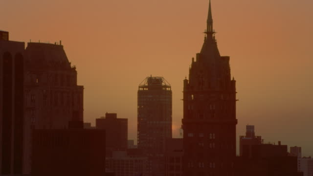 time lapse sunrise behind silhouettes of buildings / new york city - manhattan stock videos & royalty-free footage