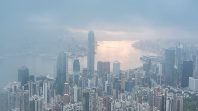 time lapse : sunrise hong kong city skyscraper buildings - modern city business district - victoria peak stock videos & royalty-free footage