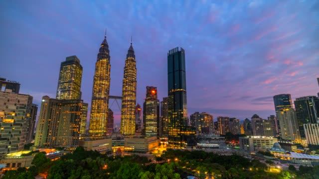4k time lapse sunrise, night to day scene of kuala lumpur skyline landmark with petronas twin tower, malaysia - petronas twin towers stock videos & royalty-free footage
