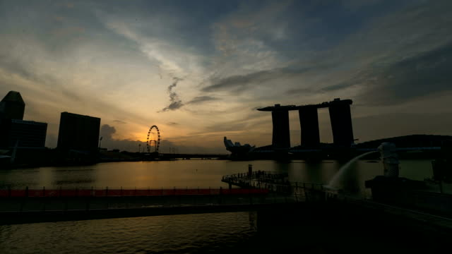 time lapse  sunrise of singapore marina bay with merlion. - merlion fictional character stock videos and b-roll footage