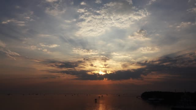 time lapse sunrise or sunset and sunbeam over the sea - horizon over water stock videos & royalty-free footage