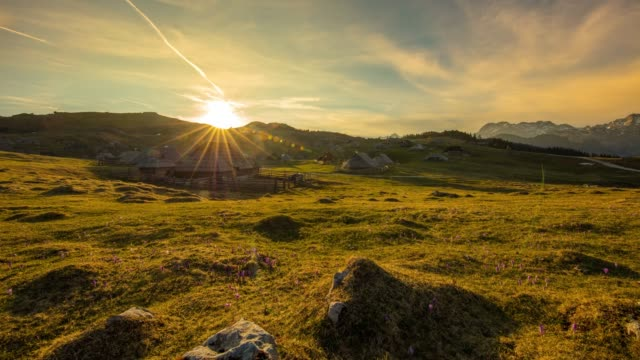 ws time lapse sunrise over tranquil,idyllic mountain landscape,herdsmens settlement,velika planina,slovenia - cottage stock videos & royalty-free footage