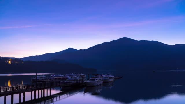 4k time lapse: sunrise timelapse of sun moon lake, taiwan. tilt down shot - sun moon lake stock videos and b-roll footage