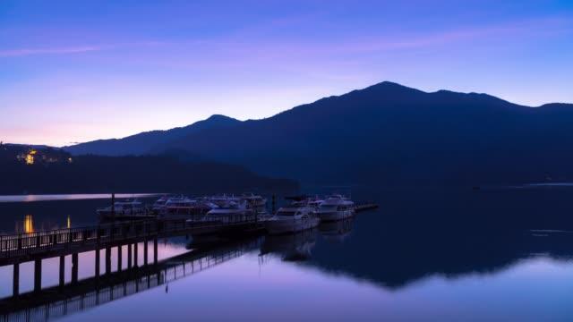 4k time lapse: sunrise timelapse of sun moon lake, taiwan - sun moon lake stock videos and b-roll footage