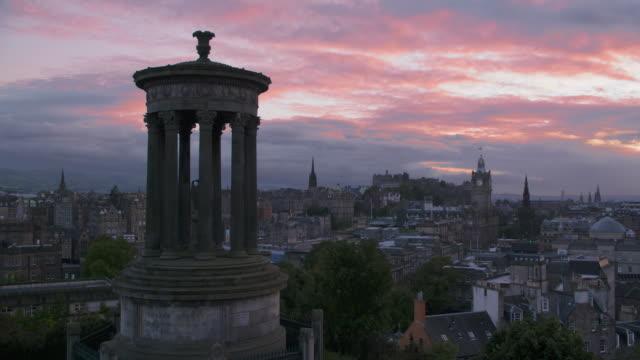 Time Lapse. Sunset clouds over Edinburgh skyline (Edinburgh castle and old city) seen from Calton hill.
