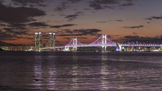 4k time lapse  : sunset  gwangandaegyo bridge in busan south korea  - city skyline modern building and architecture at night time,south korea - busan stock videos & royalty-free footage