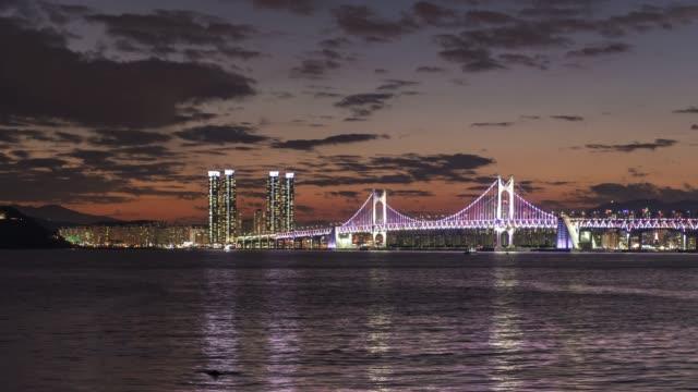 4k time lapse : sunset gwangandaegyo bridge view of city busan at night, south korea - busan stock videos & royalty-free footage