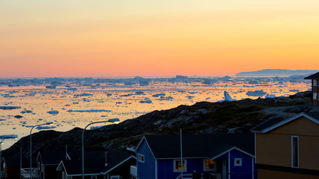 time lapse sunset ice floes climate change greenland - ice floe stock videos & royalty-free footage