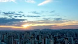 Time Lapse Sunset in capital city, Sao Paulo, Brazil. Hyper Lapse Downtown scene. City life scene. Aerial view of district of São Paulo, Brazil. Colorful skyline. Landscape. Panorama view of city. Sunlight. Urban life