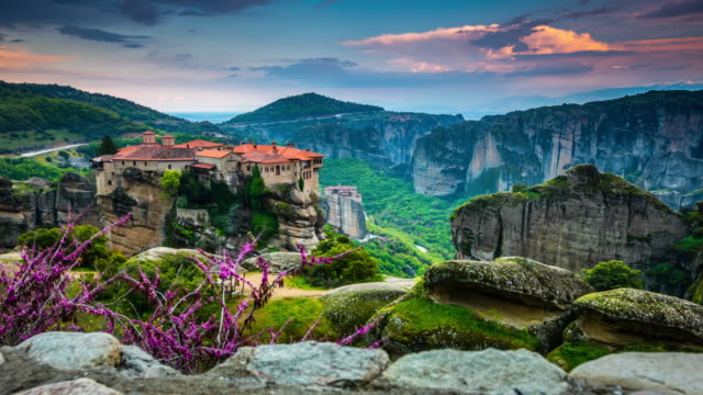 time lapse : sunset over meteora monasteries in greece - abbey stock videos & royalty-free footage