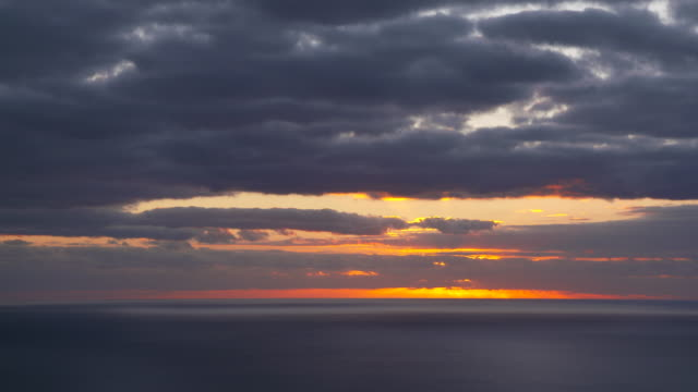time lapse. sunset over sea. view from funchal. funchal, madeira, atlantic ocean, portugal. - madeira stock videos and b-roll footage