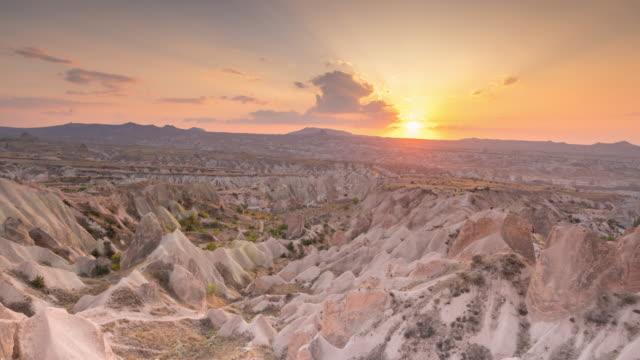time lapse : sunset panoramic ancient cave houses in goreme, cappadocia, turkey - cliff dwelling stock videos & royalty-free footage