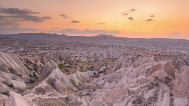 time lapse : sunset panoramic fairy chimneys in rose valley rock landscape ancient cave houses in goreme, cappadocia, turkey - cliff dwelling stock videos & royalty-free footage