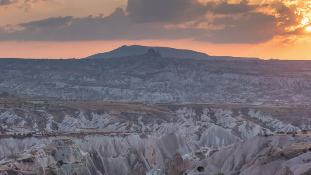 time lapse : sunset panoramic rock formations ancient cave houses near goreme, cappadocia, turkey - cliff dwelling stock videos & royalty-free footage