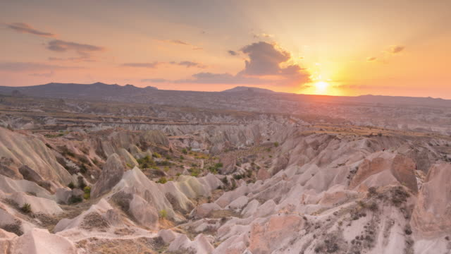 time lapse : sunset panoramic rock landscape ancient cave houses in goreme, cappadocia, turkey - cliff dwelling stock videos & royalty-free footage