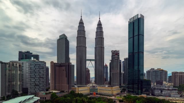 4k time lapse sunset scene of movie moving cloud and petronas twin tower of kuala lumpur city, malaysia - petronas twin towers stock videos & royalty-free footage