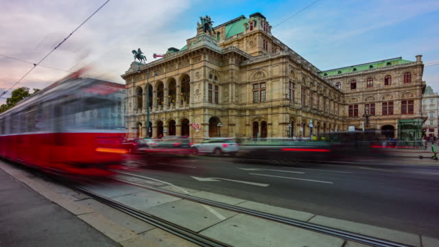 time lapse sunset scene of traffic road and people walking at front of viennese opera house, vienna, austria - vienna austria stock videos & royalty-free footage
