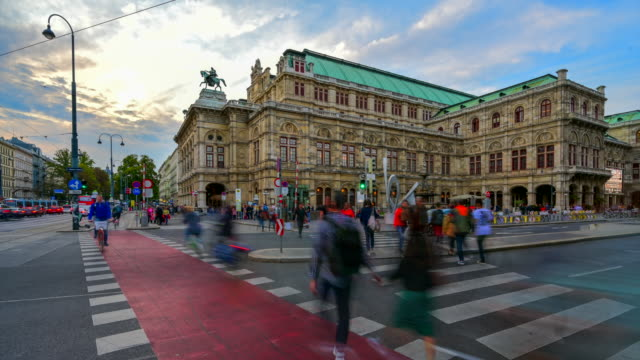 time lapse sunset scene of traffic road and people walking at front of viennese opera house, vienna, austria - traditionally austrian stock videos & royalty-free footage