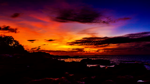 time lapse sunset / sunrise over the ocean. - dramatic sky stock videos & royalty-free footage