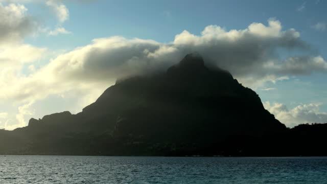 time lapse sunset view aquamarine lagoon bora bora - polynesian ethnicity stock videos & royalty-free footage