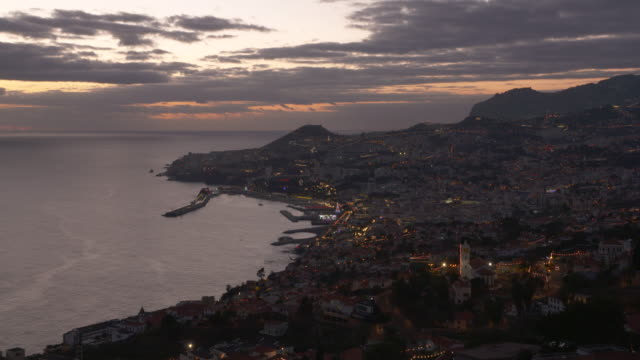 Time Lapse. Sunset view of Funchal with harbor, elevated view from the Sao Goncalo district. Funchal, Madeira, Portugal.