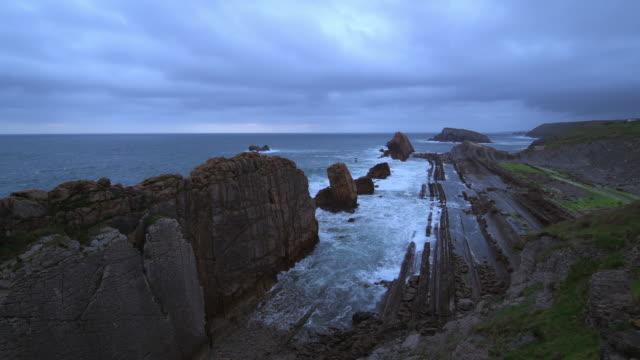 Time Lapse. Surf on the rocks of Playa de La Arnia beach near Liencres. This area is called Costa Quebrada.