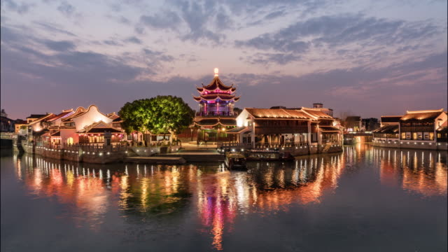 time lapse suzhou garden at sunset - bungalow stock videos and b-roll footage