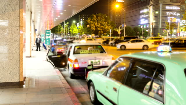 hd time lapse taxi stand at kyoto train station - taxi stand stock videos and b-roll footage
