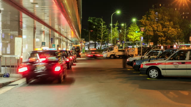 4k time lapse : taxi stand at kyoto train station - taxi stand stock videos and b-roll footage