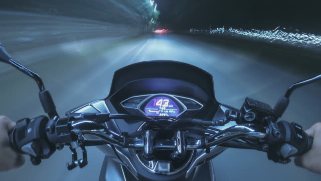 time lapse the biker is riding a motorcycle travel on the road trip at night time - scooter stock videos & royalty-free footage