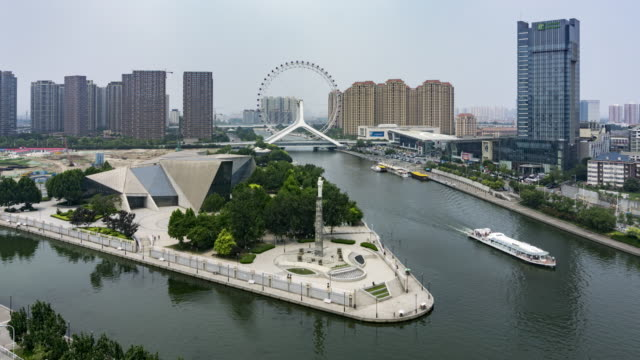time lapse- the cityscape of tianjin eye and ferris wheel - hai river stock videos & royalty-free footage