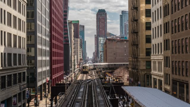 4k time lapse the loop of downtown chicago with high buildings and elevated railway in chicago, illinois, united states, business and modern transportation concept - chicago 'l' stock videos & royalty-free footage