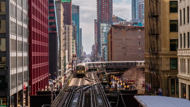 4k time lapse the loop of downtown chicago with high buildings and elevated railway in chicago, illinois, united states, business and modern transportation concept - chicago loop stock videos and b-roll footage