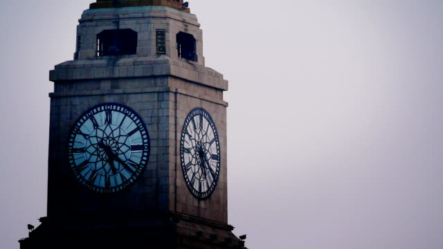time lapse: the minute hand of shanghai bund clock tower moving in the morning - roman numeral stock videos & royalty-free footage