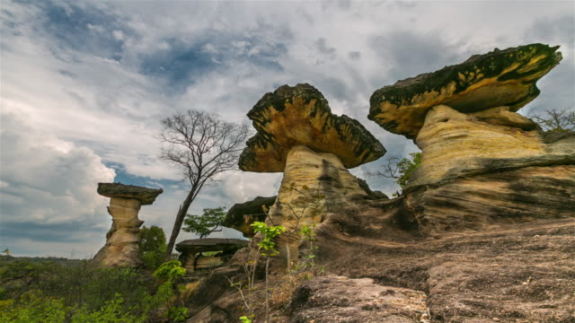 time lapse: the natural stone as mushrooms in pha taem national park, ubon ratchathani province, thailand - rock music stock videos and b-roll footage