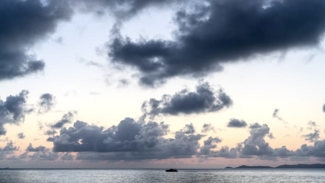 time lapse: thick, puffy clouds moving over ocean from night until dawn, sunrise, magnetic island, australia - clear sky stock videos & royalty-free footage