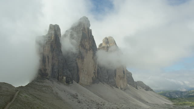 Time lapse, three peaks surrounded by clouds