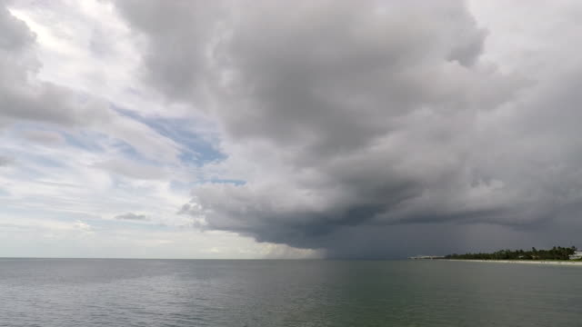time lapse: thunderstorms moving off shore of naples beach, florida - naples florida stock videos & royalty-free footage
