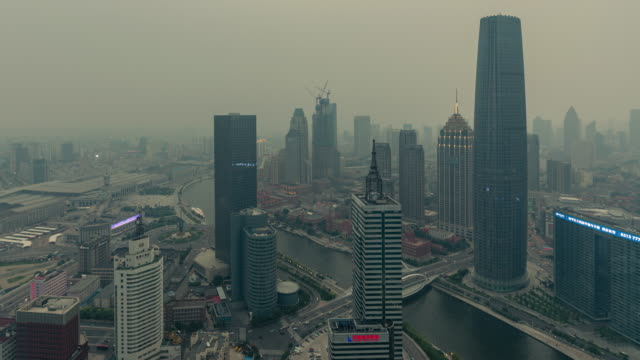 time lapse- tianjin urban skyline in air pollution, tianjin smog - hai river stock videos & royalty-free footage